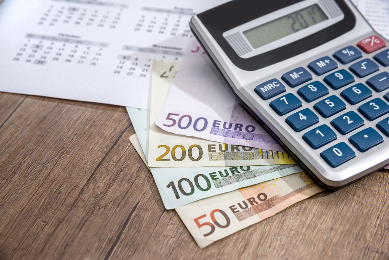 calendar, euros and calculator, coin placed on a table